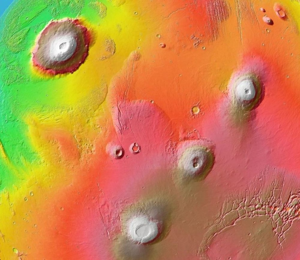 1700km-wide region of Mars including Olympus Mons (upper left) and several other volcanoes of Mars's Tharsis province. Colour-coded topography. - Image Credit: NASA/USGS/ESA/DLR/FU Berlin (G Neukum)
