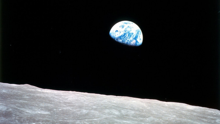 Earth rising above the surface of the moon, as seen from Apollo 8 in December 1968. - Image Credit: NASA