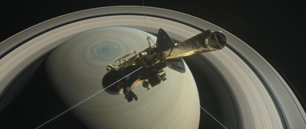 This illustration shows Cassini above Saturn's northern hemisphere prior to one of its 22 Grand Finale dives. - Image Credit: NASA/JPL-Caltech
