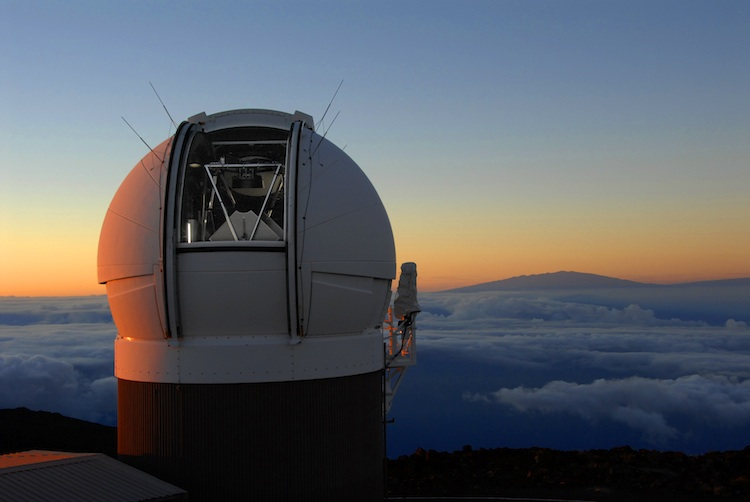 The Pan-Starrs telescope at dawn. The mountain in the distance is Mauna Kea, about 130 kilometers southeast. - Image Credit: pan-starrs.ifa.hawaii.edu