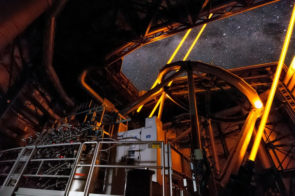 Inside the UT4 of the Very Large Telescope, part of the Adaptive Optics Facility, the four Laser Guide Stars Facility, point to the skies during the first observations using the MUSE instrument. The sharpness and dynamic range of images using the AOF equipped MUSE instrument will dramatically improve future observations. - Image Credit: Roland Bacon