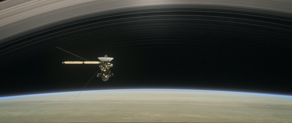 This artist's rendering shows Cassini as the spacecraft makes one of its final five dives through Saturn's upper atmosphere in August and September 2017. - Image Credits: NASA/JPL-Caltech