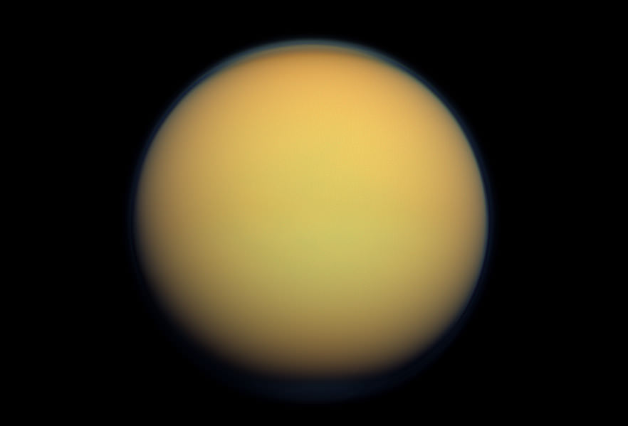 Titan's thick, nitrogen and hydrocarbon-rich atmosphere lends the planet a cloudy, yellowsh-brown appearance. - Image Credit: NASA/JPL-Caltech/Space Science Institute