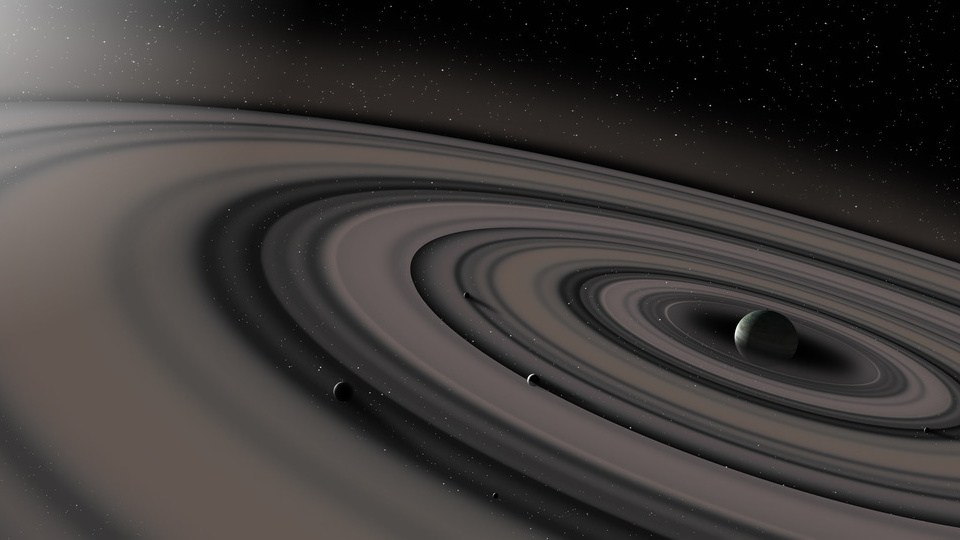 Artist's impression of an exoplanet with an extensive ring system. Image Credit: Ron Miller