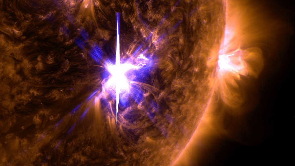 An X9.3 class solar flare flashes in the middle of the Sun on Sept. 6, 2017. - Image Credit: NASA/GSFC/SDO