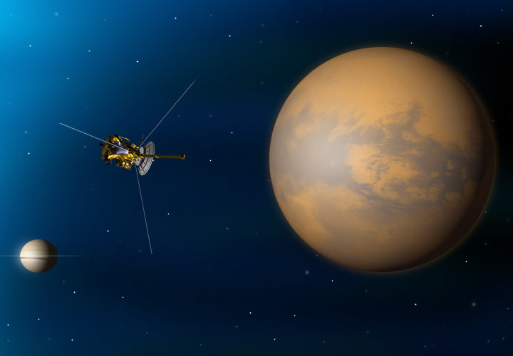 Artist's conception of Cassini winging by Saturn's moon Titan (right) with the planet in the background. Credit: NASA/JPL-Caltech