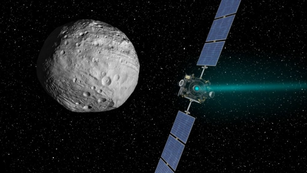 Artist's concept of the Dawn spacecraft arriving at Vesta. - Image credit: NASA/JPL-Caltech