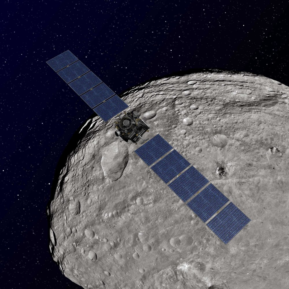 Artist rendition of Dawn spacecraft orbiting Vesta. Credit: NASA/JPL-Caltech