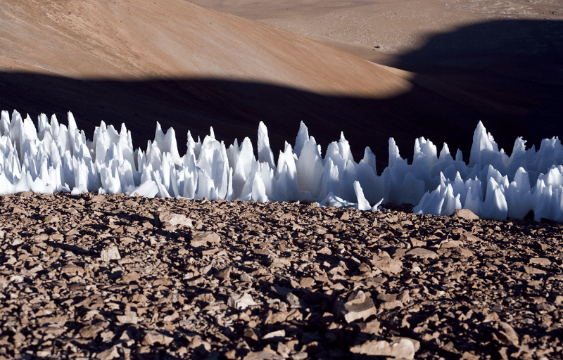 An example of the penitentes from the southern end of the Chajnantor plain in Chile. Though these ice formations only reach a few feet in height, while Pluto's bladed terrain reaches hundreds of feet, they both have similar sharp ridges. - Image Credits: Wikimedia Commons/ESO