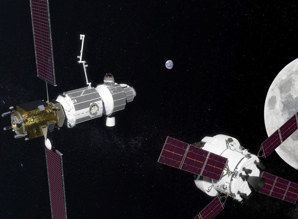 A NASA Orion craft brings a crew to the Deep Space Gateway in lunar orbit (artist's impression) - Image Credit: NASA