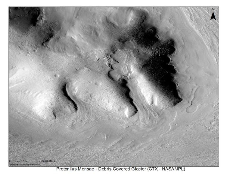Image of a buried ice deposit in the Protonilus Mensae region on Mars. These features are considered analogous to debris-covered glaciers on Earth. - Image Credit: CTX-NASA/JPL, Author provided