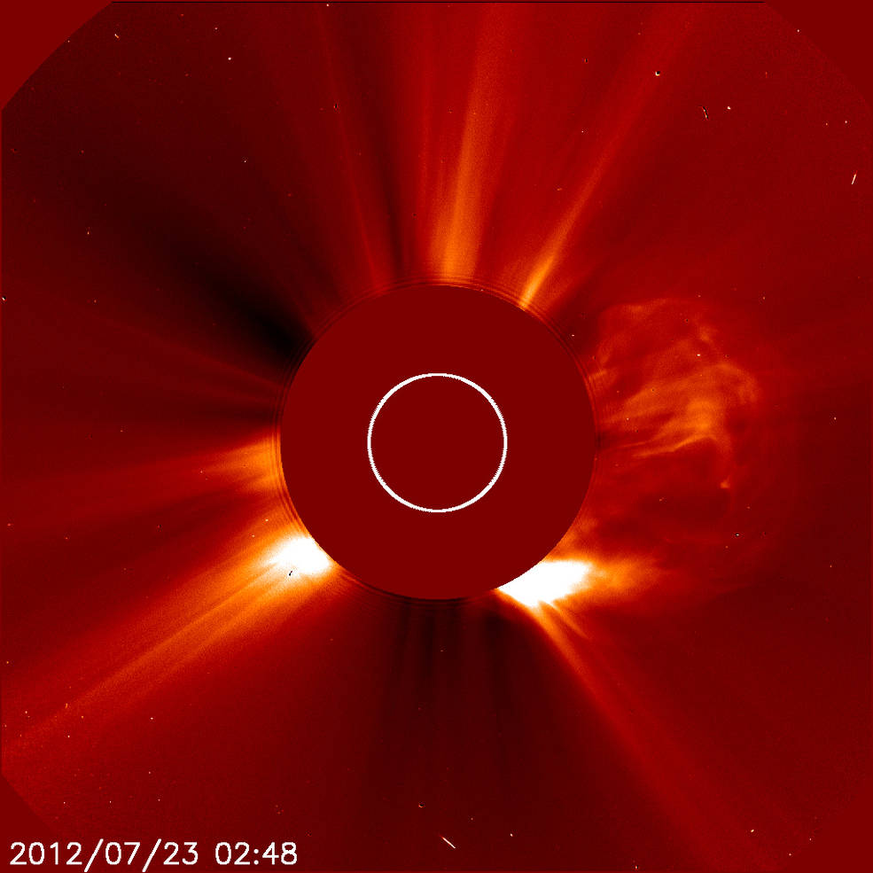 This image was captured by ESA/NASA's Solar and Heliospheric Observatory (SOHO) on July 22, 2012 at 10:48 PM EDT. On the right side, a cloud of solar material ejects from the sun in one of the fastest coronal mass ejections (CMEs) ever measured. - Image Credits: ESA&NASA/SOHO