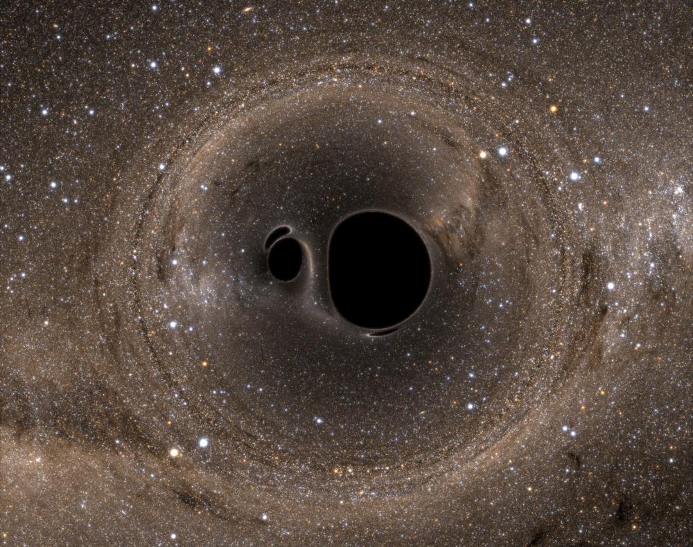 Artist's impression of binary black hole system in the process of merging. - Image Credit: Bohn et al.
