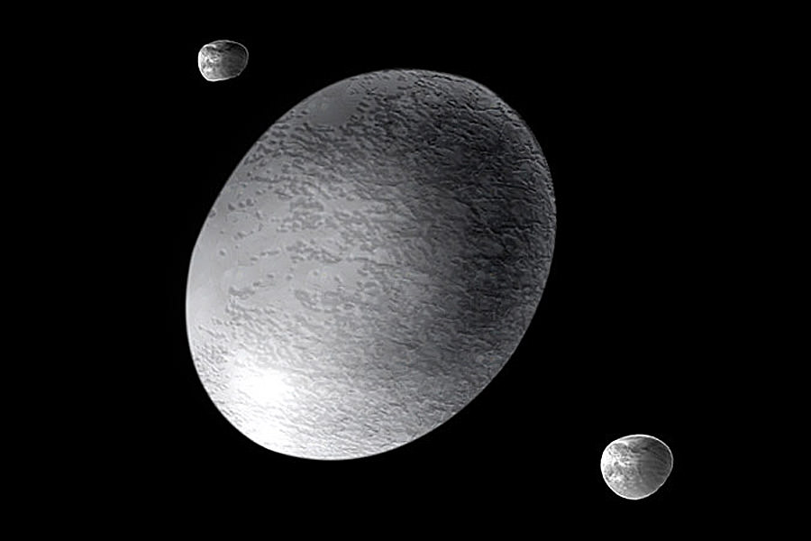 Artist's impression of the dwarf planet Haumea and its moons, Hi'aka and Namaka. - Image Credit: NASA