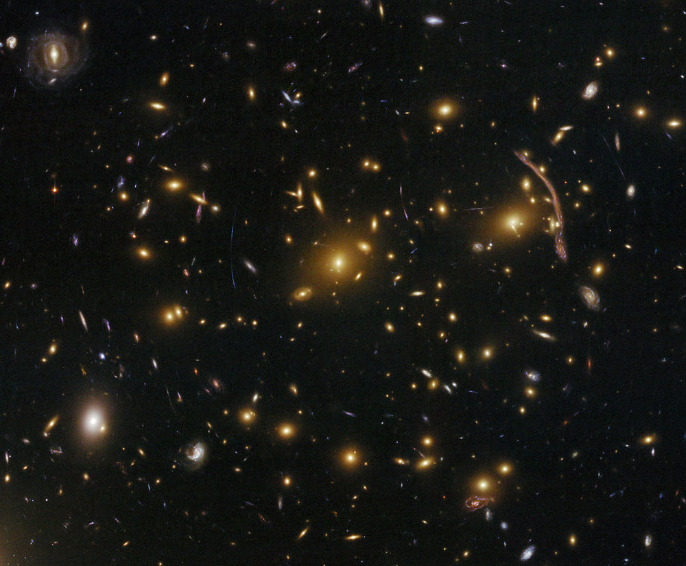 Gravitational lensing (arcs and streaks in the picture) in the galaxy cluster Abell 370. - Image Credit: NASA, ESA, the Hubble SM4 ERO Team and ST-ECF