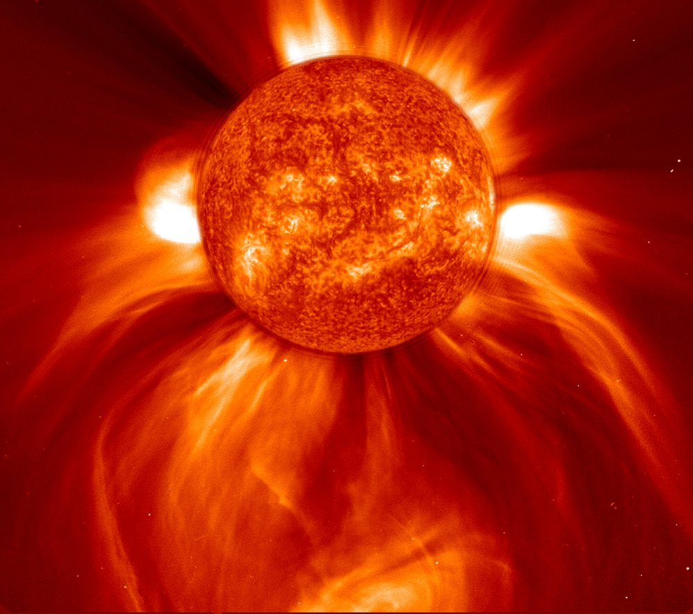 This picture, captured on Jan. 8, 2002 by the Solar and Heliospheric Observatory, shows an enormous eruption of solar material, called a coronal mass ejection, spreading out into space. - Image Credits: ESA/NASA/SOHO