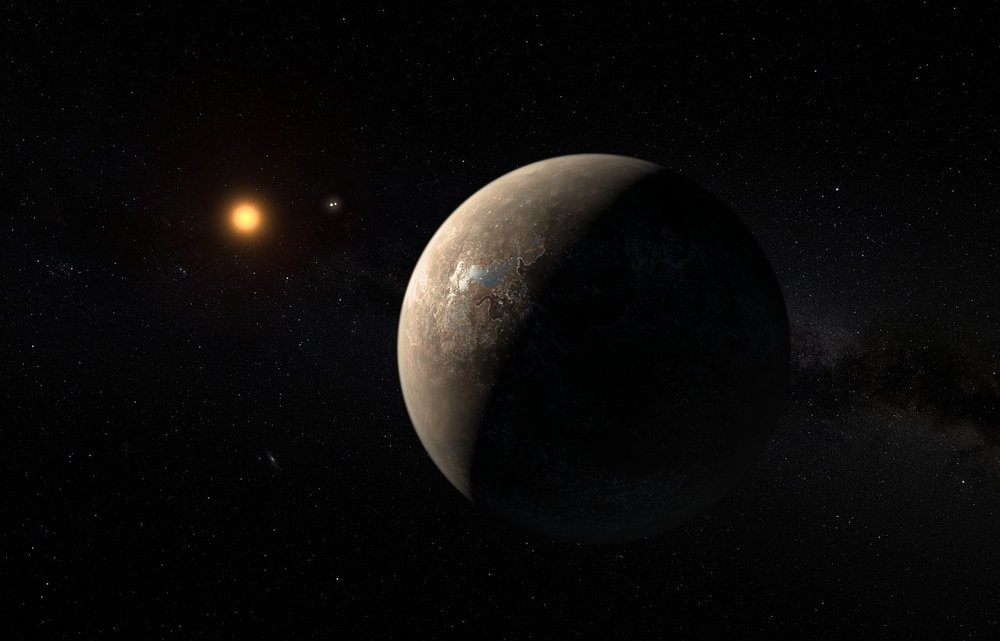 Artist's impression of Proxima b, the closest exoplanet to the Solar System. In the background, the binary system of Alpha Centauri can be seen. - Image Credit: ESO/M. Kornmesser