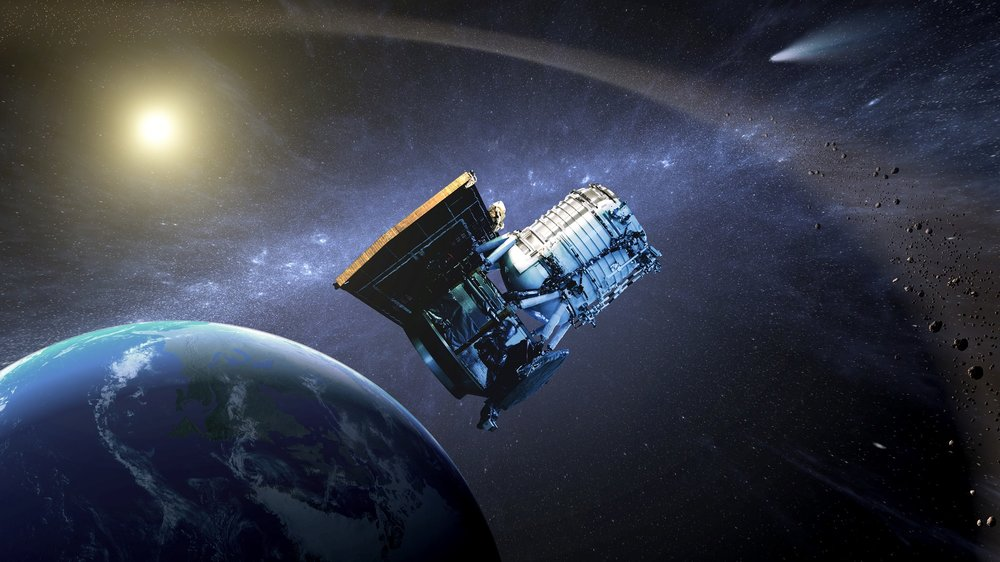 Artist's concept of the Wide-field Infrared Survey Explorer as its orbit around Earth. - Image Credit: NASA/JPL
