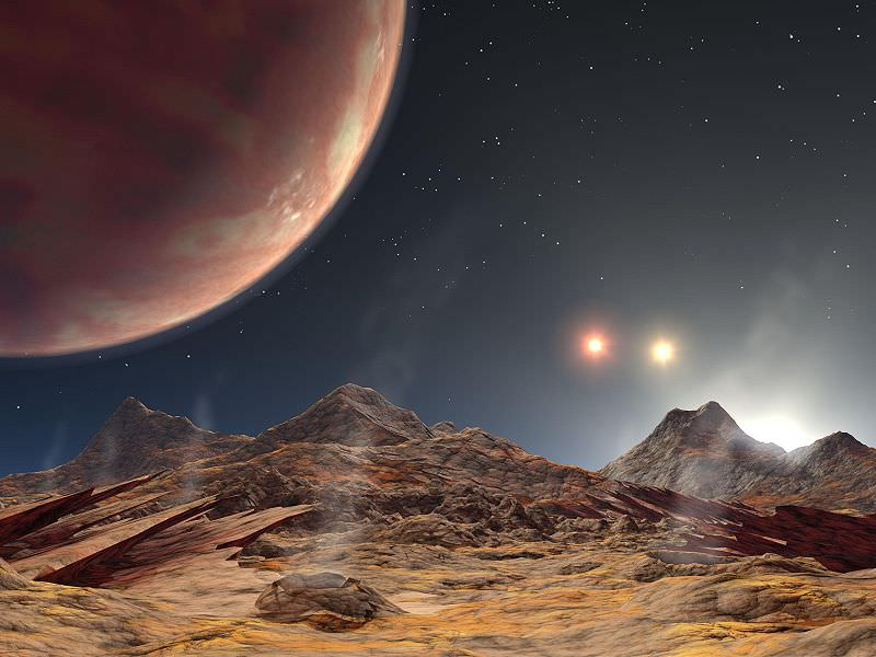 Artist's impression of the view from a hypothetical moon around a exoplanet orbiting a triple star system. - Image Credit: NASA
