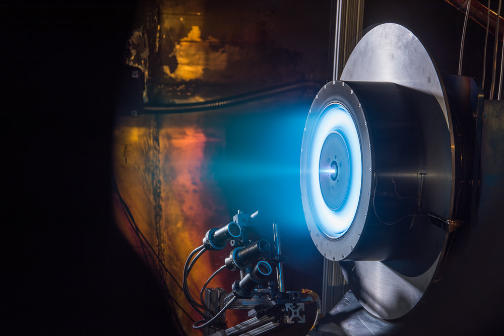 A prototype Hall-effect thruster being tested at NASA's Glenn Research Center. - Image Credit: NASA