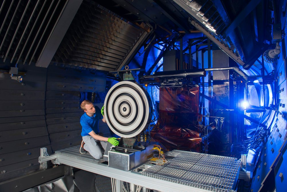 Scott Hall makes some final adjustments on the thruster before the test begins. - Image Credit: NASA
