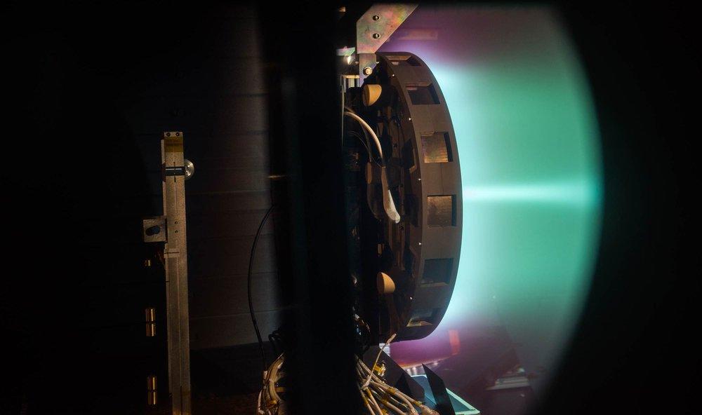A side shot of the X3 firing at 50 kilowatts. - Image Credit: NASA