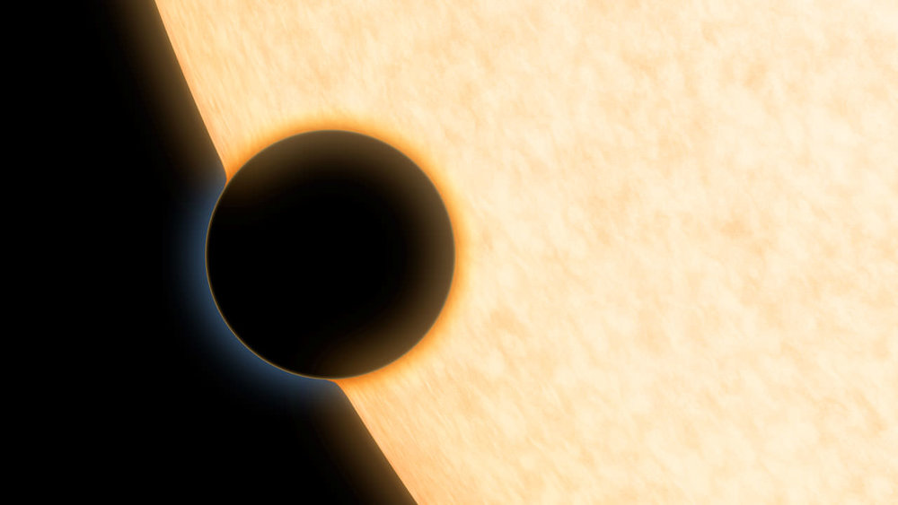 Artist's concdption of a Neptune-sized planet with a clear atmosphere, passing across the face of its star. - Image Credit: NASA/JPL-Caltech