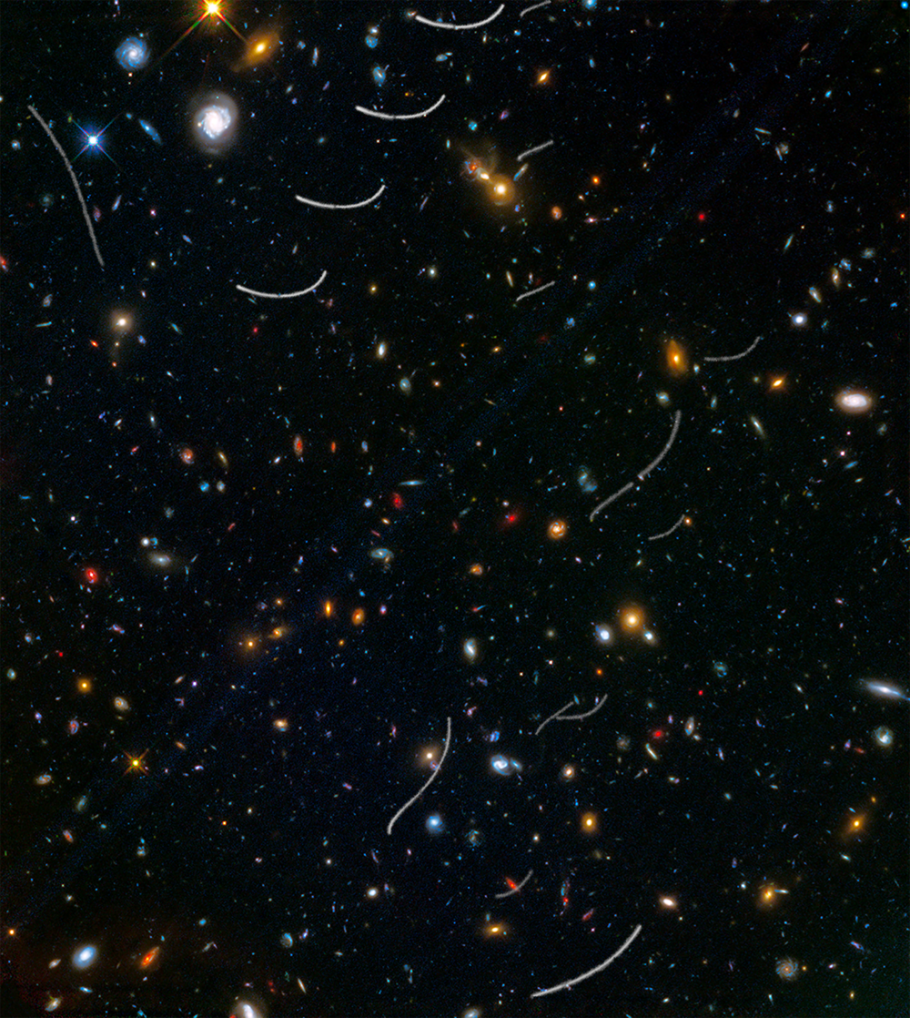 This Hubble photo of a random patch of sky is part of a survey called Frontier Fields. It contains thousands of galaxies, including massive yellowish ellipticals and majestic blue spirals. Much smaller, fragmentary blue galaxies are sprinkled throughout the field. The reddest objects are most likely the farthest galaxies. Asteroid trails appear as curved or S-shaped streaks. Asteroids appear in multiple Hubble exposures that have been combined into one image. Of the 20 total asteroid sightings for this field, seven are unique objects. - Image Credits: NASA, ESA, and B. Sunnquist and J. Mack (STScI) (click to enlarge)