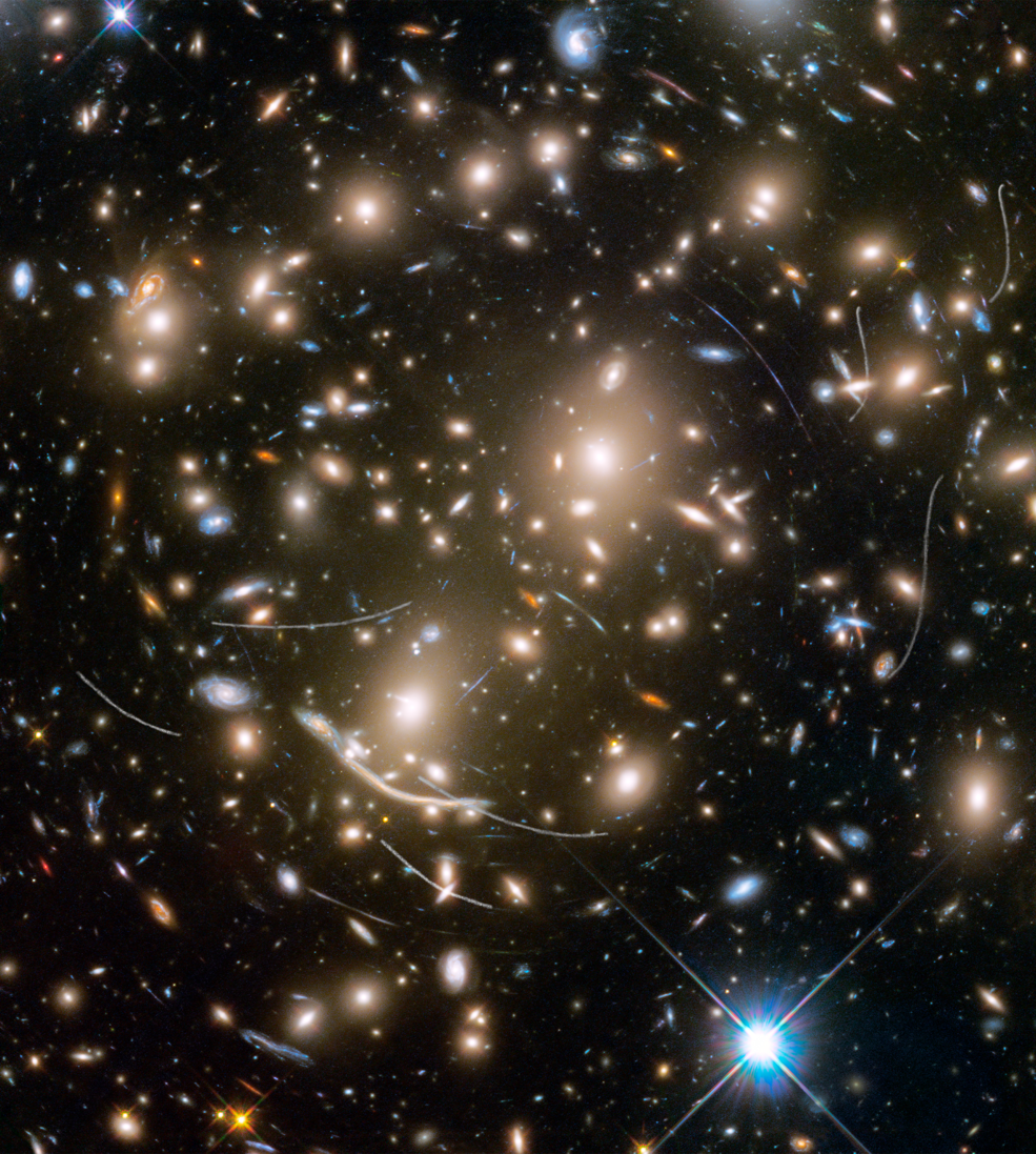 Galaxy cluster Abell 370 contains several hundred galaxies tied together by the mutual pull of gravity. It is located approximately 4 billion light-years away in the constellation Cetus, the Sea Monster. The thin, white trails that look like curved or S-shaped streaks are from asteroids that reside, on average, only about 160 million miles from Earth. The trails appear in multiple Hubble exposures that have been combined into one image. Of the 22 total asteroid sightings for this field, five are unique objects. These asteroids are so faint that they were not previously identified. - Image Credits: NASA, ESA, and STScI (click to enlarge)
