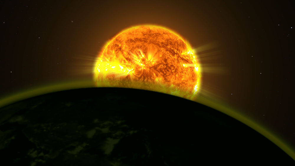 This illustration shows a star's light illuminating the atmosphere of a planet. - Image Credits: NASA Goddard Space Flight Center