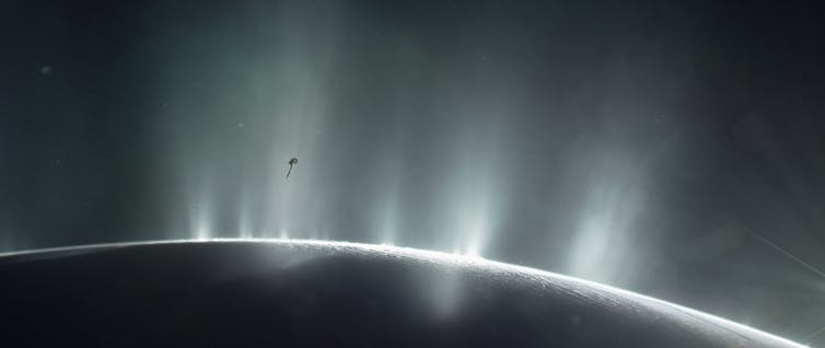 Artist's impression showing Cassini driving through geysers. NASA