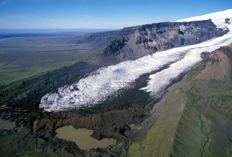 These glacier-scoured cliffs contain a surprising abundance of old evolved lavas. Image courtesy of Snaevarr Guðmundsson., Author provided