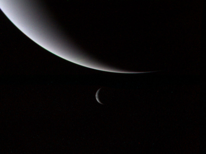 Neptune and its large moon Triton as seen by Voyager 2 on August 28th, 1989. - Image Credit: NASA