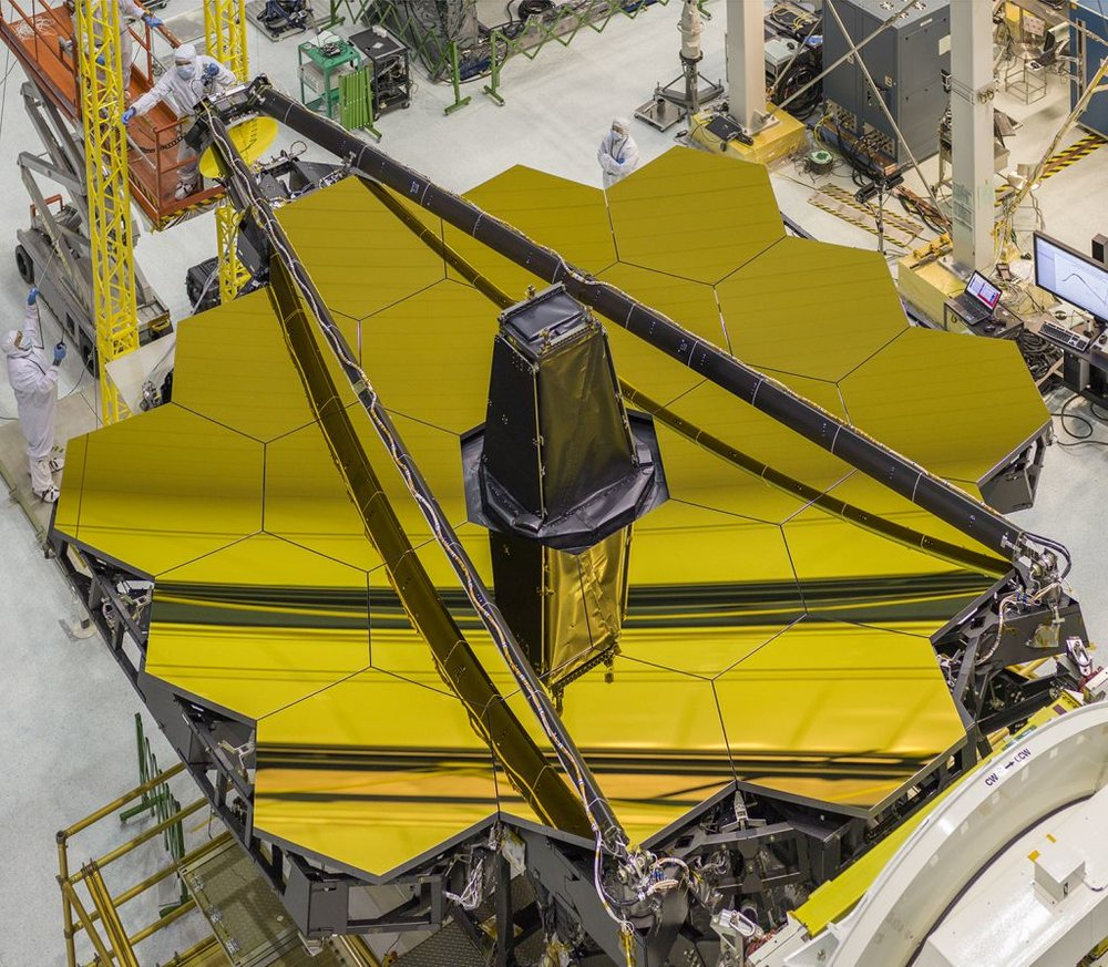 The James Webb Space Telescope's 18-segment primary mirror, a gold-coated beryllium mirror has a collecting area of 25 square meters. - Image Credit: NASA/Chris Gunn