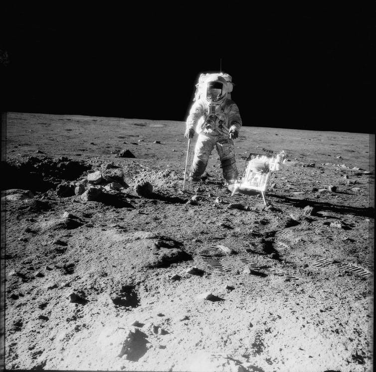 Apollo 12 crewman with tools and carrier of Apollo Lunar Hand Tools on the Moon, November 1969. - Image Credit:  NASA