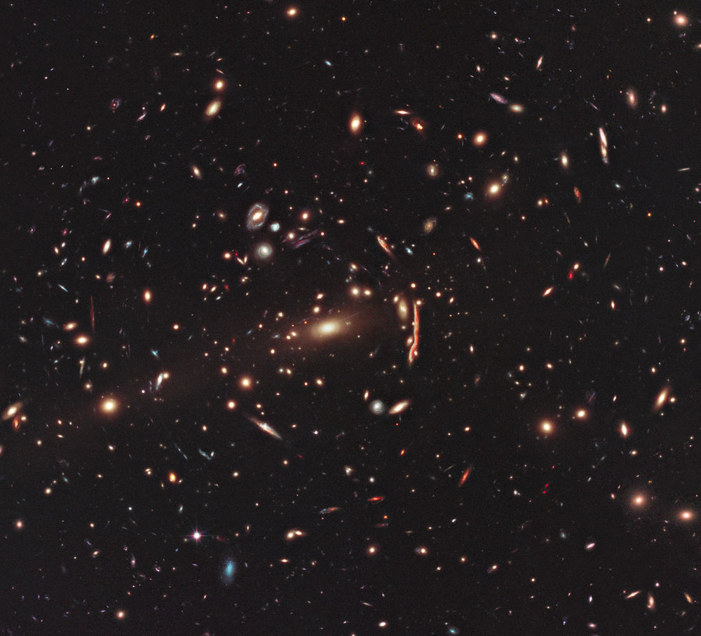 This is one of 25 clusters being studied as part of the CLASH (Cluster Lensing and Supernova survey with Hubble) programme, a major project to build a library of scientific data on lensing clusters. - Image Credit: NASA, ESA, M. Postman (STScI) and the CLASH Team