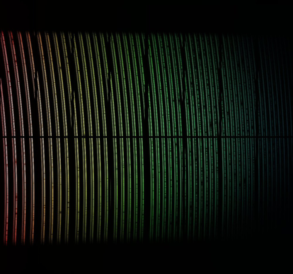 This colourful image shows spectral data from the First Light of the ESPRESSO instrument on ESO's Very Large Telescope in Chile. The light from a star has been dispersed into its component colours. This view has been colourised to indicate how the wavelengths change across the image, but these are not exactly the colours that would be seen visually. Close inspection shows many dark spectral lines in the stellar spectra and also the regular double spots from a calibration light source. The dark gaps are features of how the data is taken, and are not real. - Image Credit ESO/ESPRESSO team