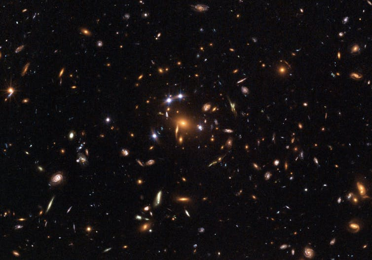 Galaxy cluster SDSS – what's pushing it apart at an accelerated rate? - Image Credit: ESA, NASA, K. Sharon (Tel Aviv University) and E. Ofek (Caltech).