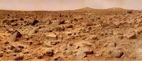 The rocks that scatter on this dusty terrain could be behind the disappearance of water on Mars. - Image Credit: NASA