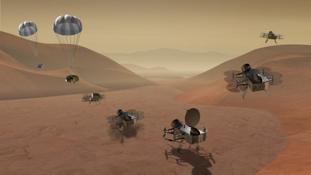 In this illustration, the Dragonfly helicopter drone is descending to the surface of Titan. - Image Credit: NASA