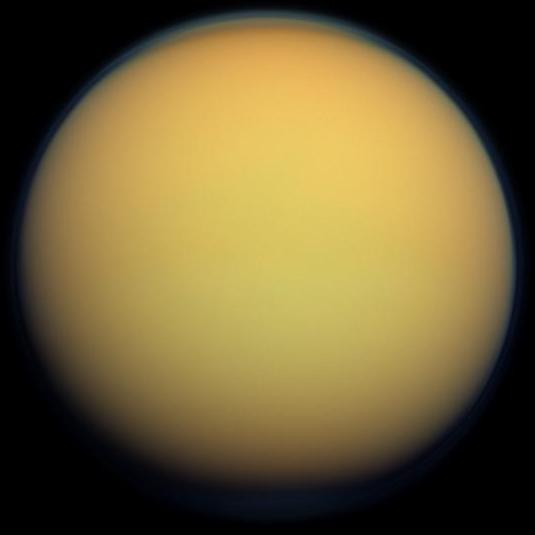 This true-color image of Titan, taken by the Cassini spacecraft, shows the moon's thick, hazy atmosphere. - Image Credit: By NASA