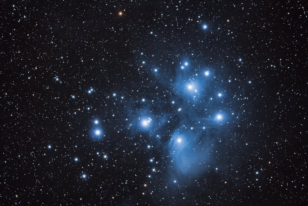 The most luminous stars in the Pleiades star cluster are blue. - Image Credit: Flickr/Joel Tonyan, CC BY-NC-ND