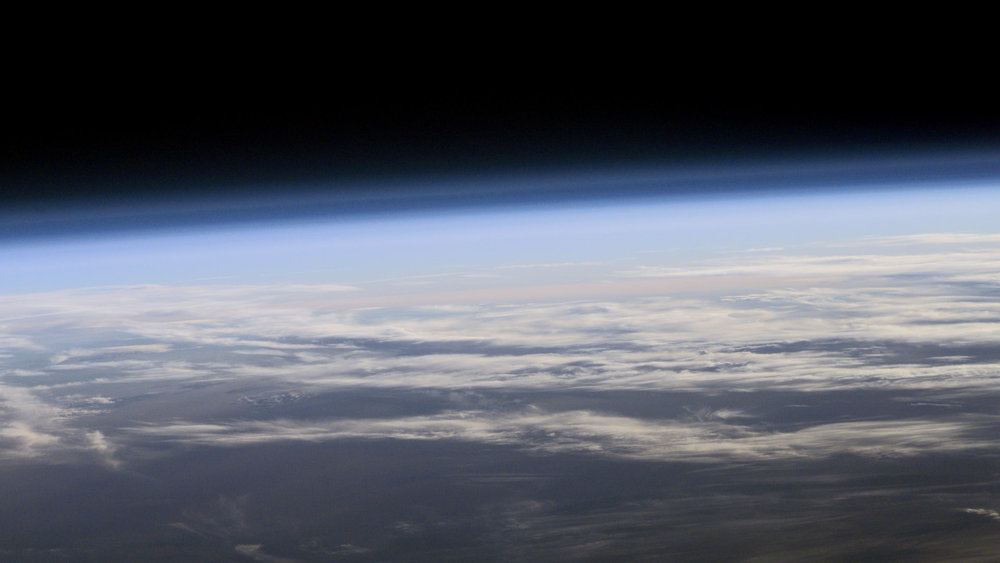 A view of Earth's atmosphere from space. - Image Credit: NASA