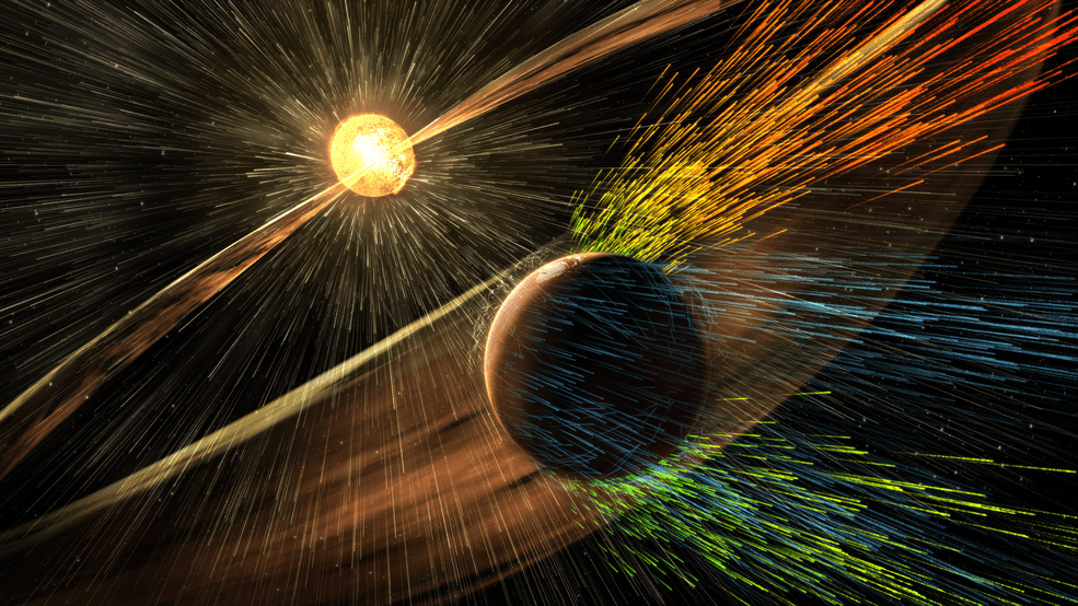 Artist's rendering of a solar storm hitting Mars and stripping ions from the planet's upper atmosphere. - Image Credits: NASA/GSFC