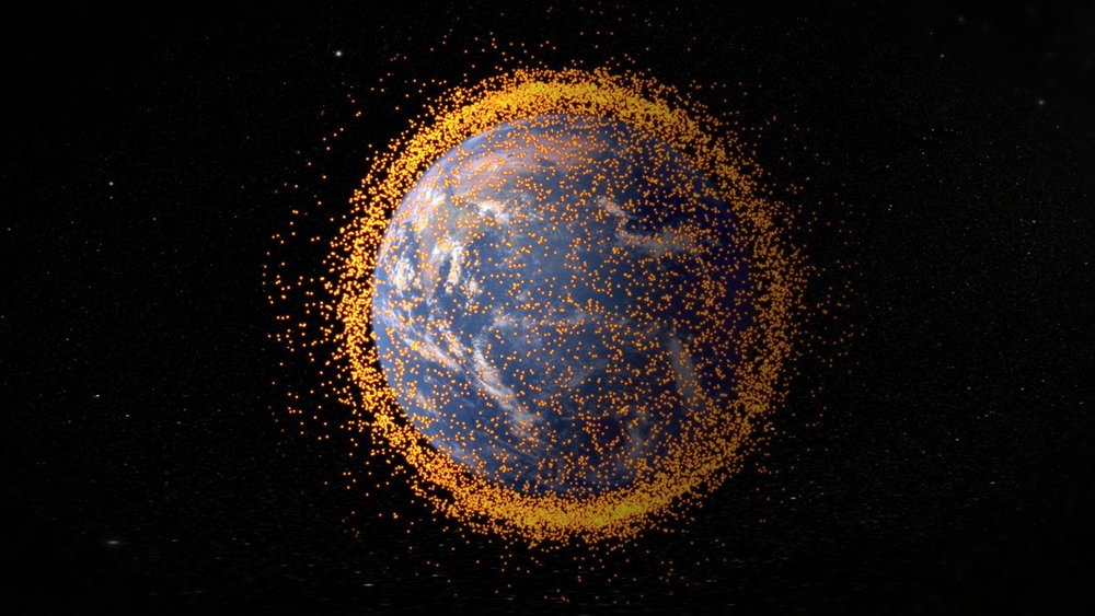 Graphic showing the cloud of space debris that currently surrounds the Earth. - Image Credit: NASA's Goddard Space Flight Center/JSC