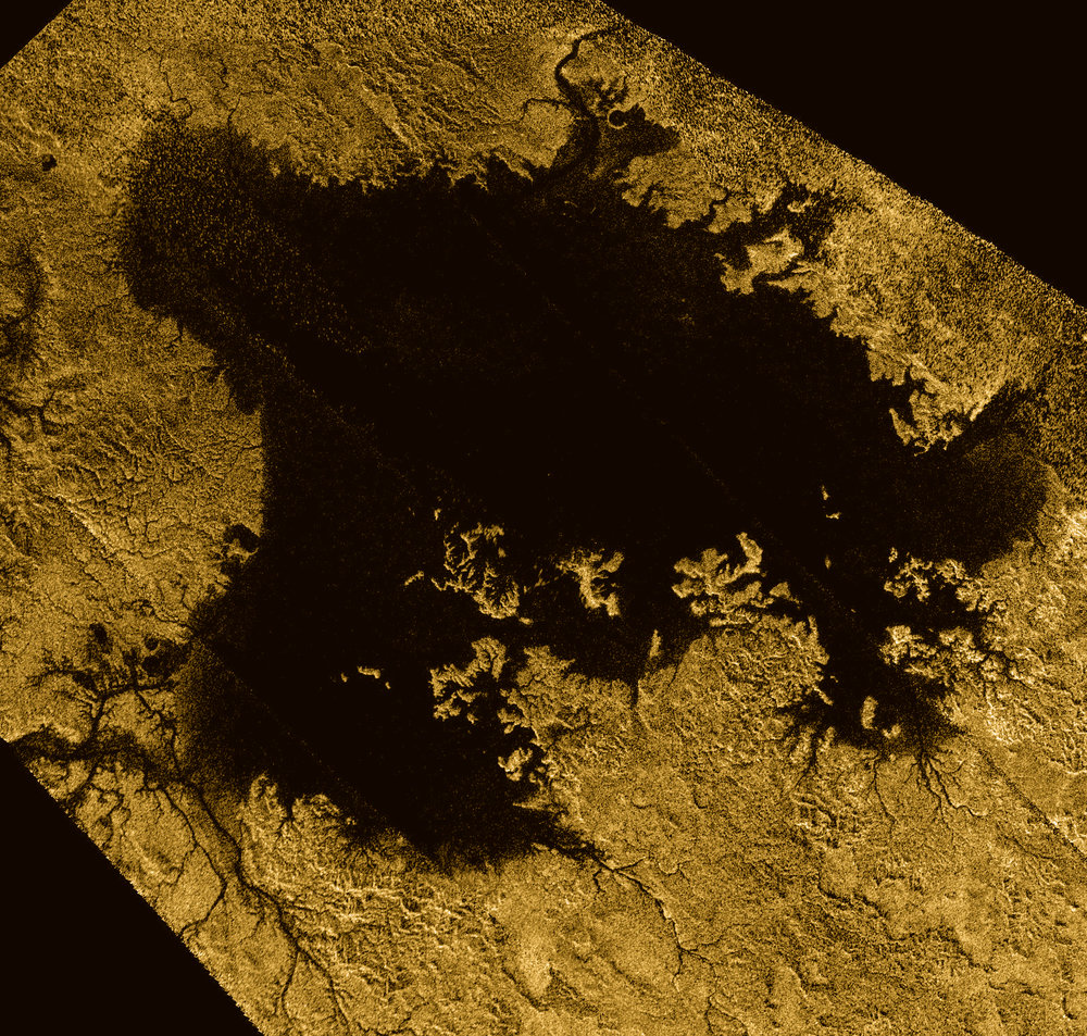 Ligeia Mare, shown in here in data obtained by NASA's Cassini spacecraft, is the second largest known body of liquid on Saturn's moon Titan. It is filled with liquid hydrocarbons, such as ethane and methane, and is one of the many seas and lakes that bejewel Titan's north polar region. - Image Credits: NASA/JPL-Caltech/ASI/Cornell