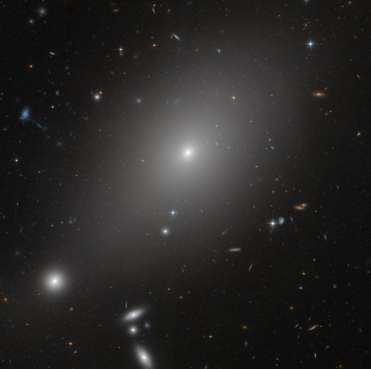 Elliptical galaxy called ESO 306-17 in the southern sky. - Image Credit: NASA, ESA and Michael West (ESO)