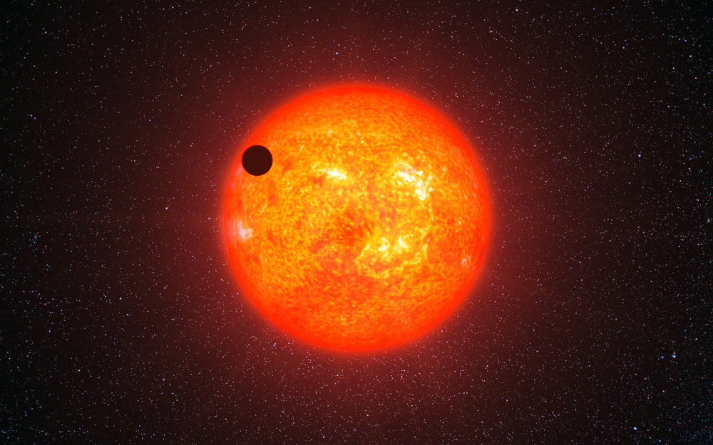 An artist's impression of a super-earth extra-solar planet transiting its home star - Image Credit:ESO/L. Calçada via Wikimedia Commons