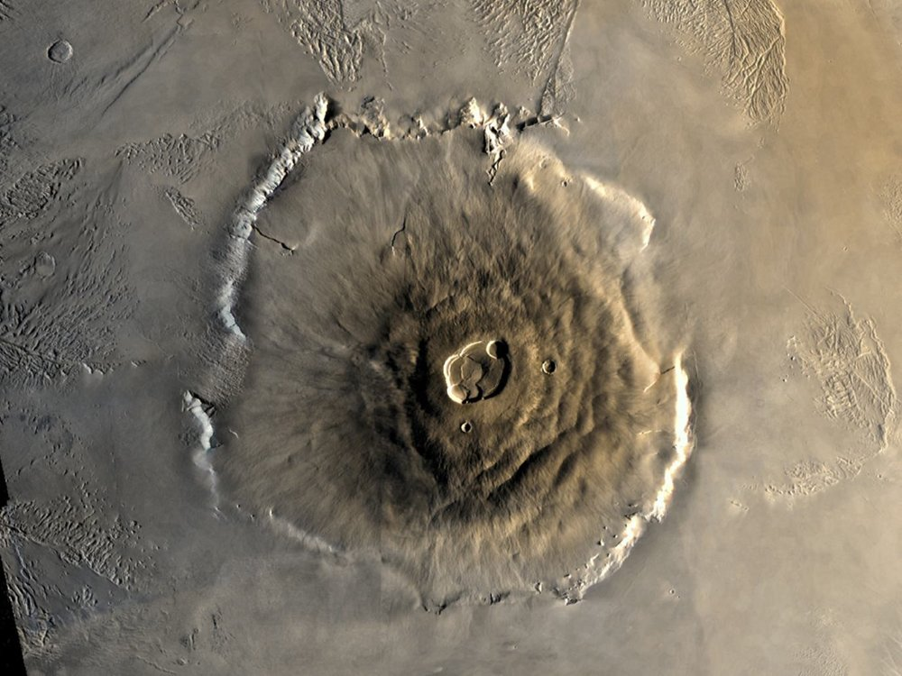 Color mosaic of Mars' greatest mountain, Olympus Mons, viewed from orbit. - Image Credit NASA/JPL