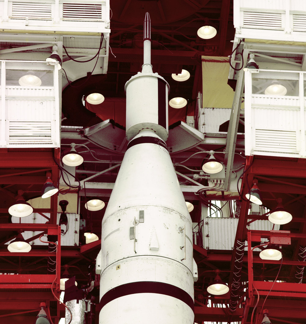 In the gantry at Space Launch Complex 26 at Cape Canaveral Missile Annex (now Cape Canaveral Air Force Station), the Explorer 1 is mounted atop a Jupiter-C rocket in preparation for liftoff of the first American satellite. The launch vehicle consisted of a modified version of the Redstone rocket's first stage and two upper stages of clustered Sergeant rockets developed by the Jet Propulsion Laboratory. - Image Credits: NASA (click to enlarge)